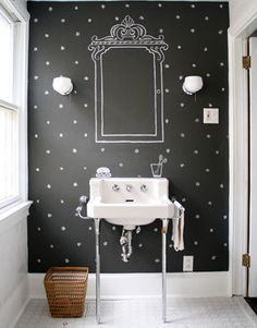 Image of a bathroom with a chalkboard wall