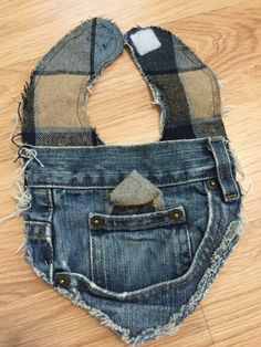 Stylish denim bibs made from repurposed denim jeans that compliments any little gentlemens attire! Made for infant/toddler ages 0-2. This bib features a front pocket with plaid cotton/wool blend material. Two layers of denim that sits on front of babies/childs chest. Backing is made of denim. Also features a belt loop that would be great for attaching pacifier! Durable yet stylish for those little ones who need to protect their clothes from drooling or during meal time. Clasps are velcro…