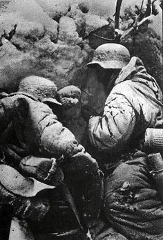 Two German soldiers in a trench during the Battle of Stalingrad. They look almost frozen...