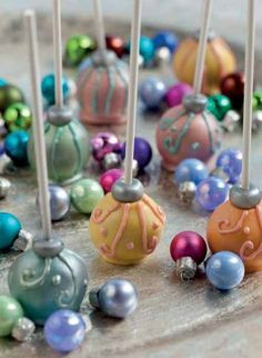 A Glisten and a Glow: Simply Sweet Home shared this gorgeous idea for cake pops that look just like glass ornaments. Leave the red and green behind — jewel tones and silver accents are just as festive!
