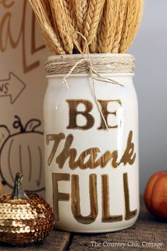 Use a mason jar, Painters paint markers, and twine to make rustic, DIY home decor for fall!