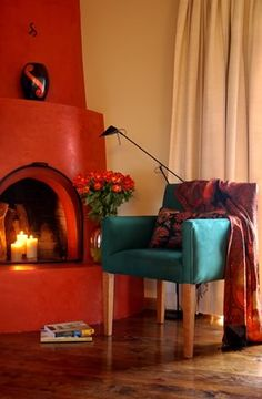 Our kiva fireplace is slightly lighter in color, but i never thought to put a fancy chair nearby. Southwestern Home Decor, Southwestern Decorating, Southwest Style, Beautiful Interior Design, Modern Interior Design, Mosaic Fireplace, Fancy Chair, Living Room Decor, Bedroom Decor