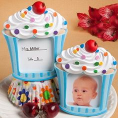 "Made of poly resin in the shape of a delectable cupcake with multicolored sprinkles on top of its delicately swirled vanilla frosting  The """"cupcake wrapper"""" bottom has a blue on darker blue stripe pattern that frames the picture/placecard opening Each measures 4"""" x 3.25"""" Has a central picture window fit for the insertion of a 1.75"""" square photo or place card A delicious - and useful - choice for all little boy themed occasions   #timelesstreasure"