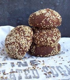 Rye-style because these buns are gluten free. Black sorghum flour hooks up with cocoa powder and coffee in a blackish seeded bun. If you don't have black sorghum, no worries. Use white sorghum or b...