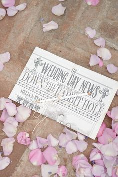 For a Mad Hatter themed wedding, a typical program won't do! This couple created a newspaper Wedding Day News for a fun program alternative