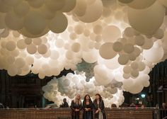 French artist Charles Pétillon installed a giant cloud of balloons under the roof of the 19th-century Market Building in London's Covent Garden.