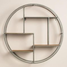 One of my favorite discoveries at WorldMarket.com: Round Wood and Metal Mateo Wall Storage