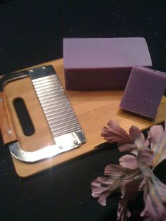 39cc29ee81df YesterYear Soap Company  Loaf of Soap  with a soap cutter and cutting board.