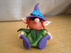 Elf Figurine with flower hat, polymer clay OOAK miniature fantasy creature handmade on Etsy, 15,89 €