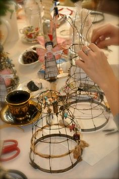 class making wire cage dolls with china tea cups and saucers. Wish there was a tutorial.
