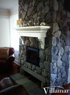 mantal fireplace river rocks westcoast design custom home builder construction by Villamar Construction Victoria BC