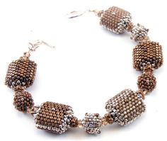 peyote stitch beaded beads in a glowing silk-satin taupe, rich matte brown, and shiny bronze. All are highlighted with sterling silver Czech charlottes. Accent beads are sterling silver, bronze and Swarovski Beaded Beads, Beads Jewelry, Beads And Wire, Jewelry Art, Jewelry Bracelets, Beaded Necklace, Jewelry Design, Swarovski Bracelet, Swarovski Jewelry