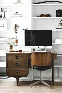 Mid Century Modern workspace with white shelving backed with thin shiplap.