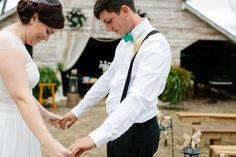 Hadley and Kodi's first look in front of the barn at their Vintage Rustic Georgia Wedding at Fritz Farm. Photo: TR Photography