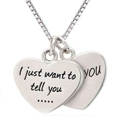 """Remind that someone special everyday how much they are loved with this lovely little peice,a double heart necklace with the words """" I just want to tell you I lo"""