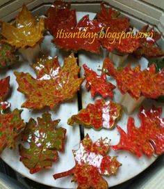 fall leaves. terra cotta clay and Sax true flow colorburst glaze