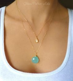 A lovely layered necklace exudes eye catching sparkle.... - A dainty crystal and genuine aqua chalcedony dangle together to make one beautiful necklace - Chain is available in 14k gold filled or sterl