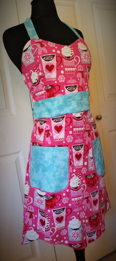 Here is a very festive #apron that will having you feeling good about the way you look while you are baking in the kitchen.  I made this apron with two prints. One print has... #holidays #giftgiving #gift #mothersday #easter #winter