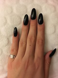 Almond shaped black acrylic nails. Long. Pointed