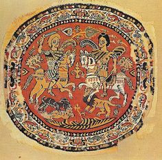 6th Century AD: Decorative roundel with two horseman. Wool on linen. Egyptian. Textile Museum, Washington, USA.