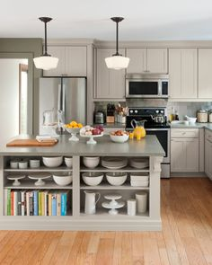 In a kitchen unused space is wasted space. Exterior shelves turn idle walls into the perfect place to store unique or oversized bowls and serving pieces.Learn more about Martha Stewart Living kitchens at The Home Depot.
