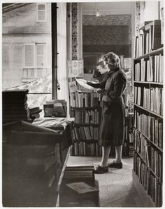 Sylvia Beach in the upstairs apartment where she hid her books during the German occupation of Paris (1945) by David E. Scherman  Beach (1887-1962), an American-born bookseller and publisher, opened an English language bookstore and lending library in Paris named Shakespeare and Company which attracted both French and American readers - including a number of aspiring writers.  Shakespeare and Company gained considerable fame after it published James Joyce's Ulysses in 1922, as a result