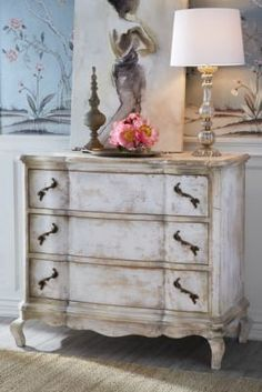 Gorgeous details abound on this elegant 3-drawer chest - from the serpentine carved front and ornate antiqued brass hardware to the delicately scrolled apron and petite cabrio