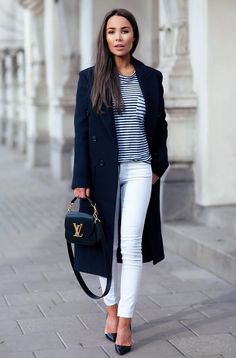 structured navy coat with striped tee and white jeans