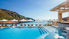 Take a dip in the gorgeous infinity pool or sit with a cocktail at the swim-up bar... Daios Cove Luxury Resort - Crete, Greece