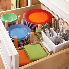 Pegged Compartments  Great storage idea, but those dishes are so pretty, I'd love to display them!