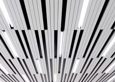La SHED Architecture separates eye clinic into light and dark zones Open Ceiling, White Ceiling, Ceiling Lights, La Shed Architecture, Frame By Frame Animation, Canopy Design, Design Furniture, Commercial Interiors, Ceiling Design