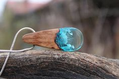 #BlueResinNecklace #Woodresinpendant #TealNecklaceWooden