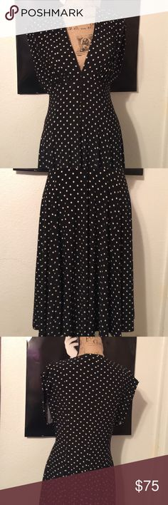 "Norma Kamali Polka Dot Dress 👗 Never worn size xl. I have had this for a little while because I love vintage and vintage inspired items. This looks like something from the 40's but I never wore it. It is made of 94% polyester and 6% spandex so it has a lot of give and it is a heavier dress. It has an empire waist and little pleating at the shoulders. It has a v neck line and it measures 19"" armpit to armpit and it is 43"" long measured from back of collar to hem. The waist measures…"