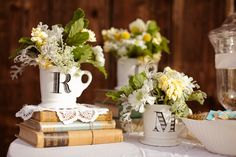 initialed mugs as vases-so cute!