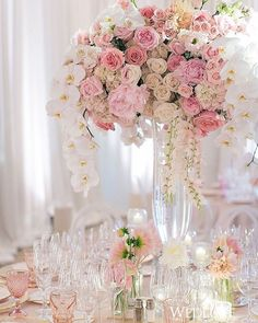 Etched blush goblets from Casa de Perrin gave the table design a jolt of feminine flair. Not to mention the stunning centrepiece filled with roses, peonies, and cascading orchids | WedLuxe Magazine