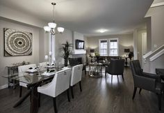 Duplex Showhome - Vesta Collection at Coopers Crossing in Airdrie Alberta Dining Table, Furniture, Collection, Design, Home Decor, Decoration Home, Room Decor, Dinner Table
