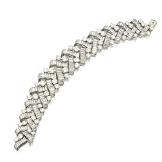 PLATINUM AND DIAMOND BRACELET, BOUCHERON,  PARIS, CIRCA 1960. Round and baguette diamonds weighing a total of approximately 40.00 carats, length 7 inches, signed Boucheron, Paris, numbered 6064, French assay marks.