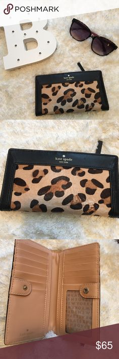 Kate spade cheetah print wallet Kate spade cheetah print and black wallet. 100% cow leather. Used a bunch of times. Some of the calf hair has come off and has faded. kate spade Bags Wallets