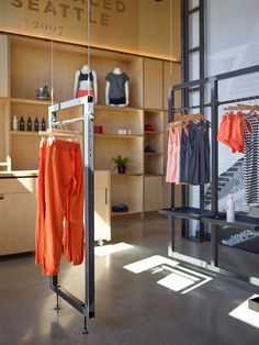 Oiselle Flagship - The Oiselle flagship store in Seattle is a bright, inviting space featuring an awe-inspiring suspended clothing display system that can be elevated...