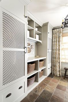 hidden laundry appliances - custom cabinets conceal laundry appliances - Revival Construction via Atticmag Laundry Doors, Mudroom Laundry Room, Laundry Room Design, Hidden Laundry Rooms, Laundry Chute, Hidden Kitchen, Laundry Area, Laundry Storage, Garage Storage