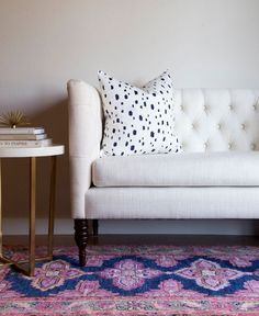 kismet rug in navy - colors: navy, pink, yellow gold, coral, grey, mint, off white; hand knotted, non-returnable, 5'x7', $735, 8'x10', $1,600. Sofa, side table, cushion, interior