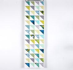 """Sew a gorgeous addition to your decor with the Free Spirit Custom Table Runner Kit! You'll receive an easy-to-piece Amy Gibson pattern and delightful True Colors fabric to create this 16"""" x 56"""" runner. Featuring an enchanting blend of modern fabric and fun, simple piecing, this project is perfect for quilters of all levels!   You can also join instructor Amy Gibson in the online Craftsy class, Learn to Quilt: Custom Table Runner and enjoy step-by-step guidance through this entire project."""
