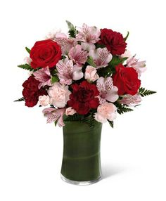 Flowers...red rose, pink and red carnation, pink alstroemerias (also called Peruvian lilies)