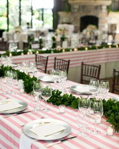 Pink and white with a garland of greenery
