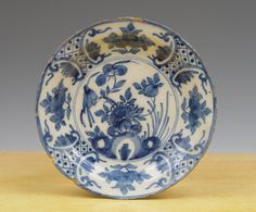 A dutch delft tile 17th century. A superb small Dutch Delft dish painted in blue decorated after a Wan-li example. in the centre with floral and flower motife in which a bird bordered by panelled flowers -. | eBay!