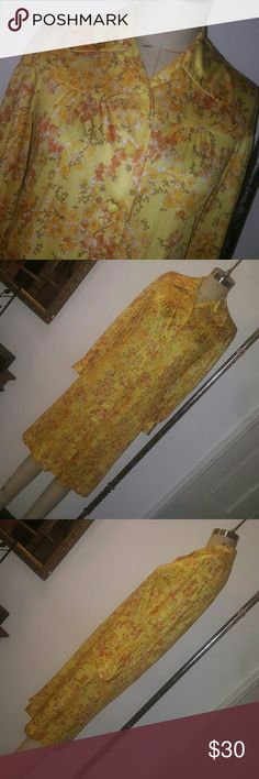 Vintage flower girl Vintage 1960's button down polyester floral print dress.  Long sleeves with buttoned cuffs. Dress has belt loops but does not come with a belt.  Sz 10 B 36in W 36in H 40in L 41in Dresses