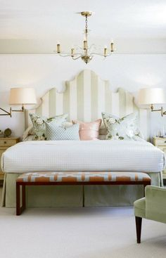 I enjoy the bench and the neutral striped headboard.