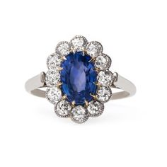 Vintage sapphire & diamond halo engagement ring // Solvang from Trumpet & Horn // $6,500