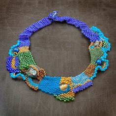 Freeform beadwoven necklace by mariellascode on Etsy. Peyote and other stitches, bead embellishments.