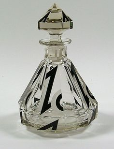 A heavy Art Deco style decanter with cut, engraved and black enamel decoration, Bohemia c.1930